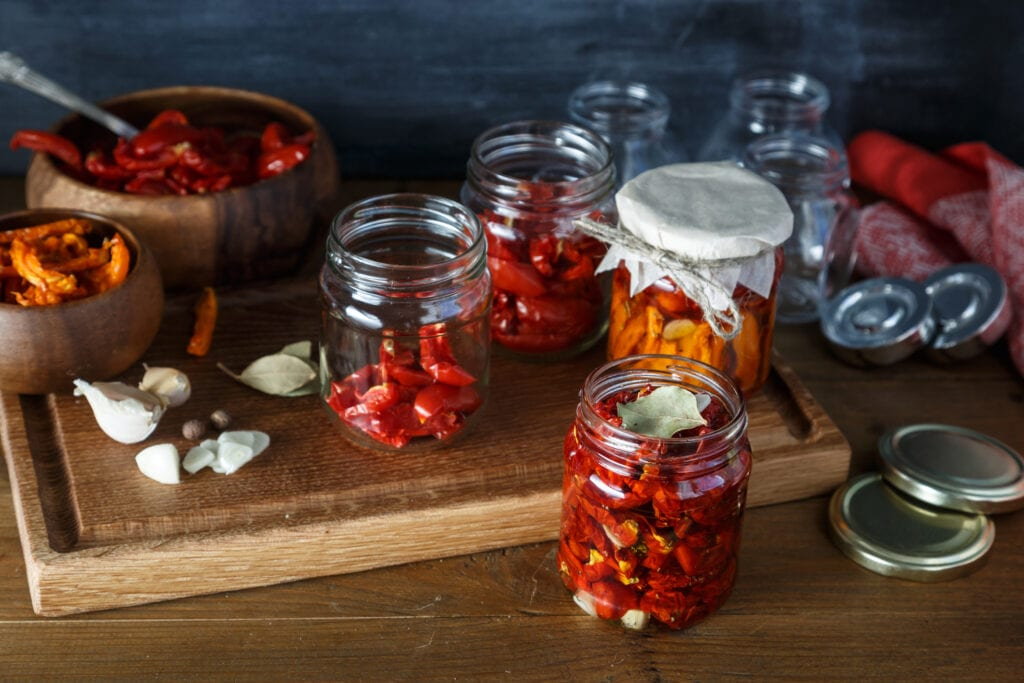 Store sun-dried tomatoes in jars once they have dried completely. Add oil, feta or other vegetables for a variety of flavours.